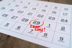 Calendar with marking in red ink of leap day: 29 february. With handwritten text of leap day. Close up with small depth of field.