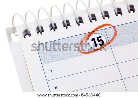 calendar with painted red tag. appointment for taxation and finance