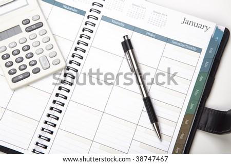 Calendar With Pen And Calculator