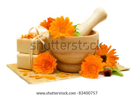 Calendula flowers with bath soap isolated - Alternative medicine and herbal treatment