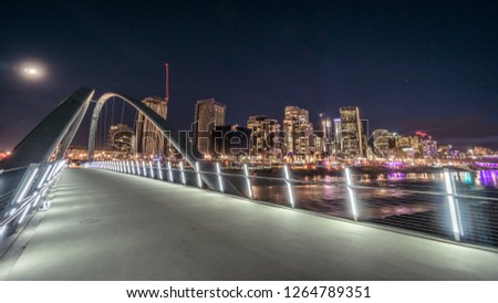 Calgary downtown at night view from bridge on Bow river, Canada