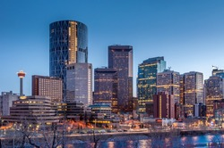 Calgary skyline at night with Bow River.