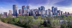 Calgary skyline at night with Bow River and Centre Street Bridge.