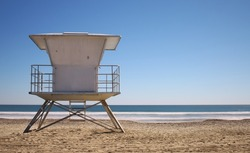 California beach with life guard tower on bright blue day with no people