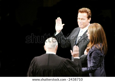 California Governor Arnold Schwarzenegger taking oath of office with Chief Justice Ronald M. George at his inauguration ceremony with First Lady Maria Shriver, January 5, 2007, Sacramento, California