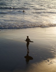 California Surfer running into the ocean