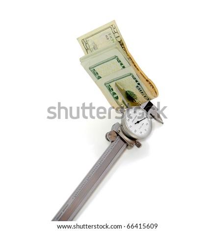 Caliper measuring a folded stack of 20 dollar bills
