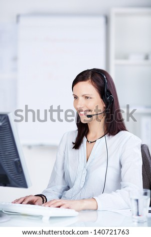 Call center agent working in front of her computer