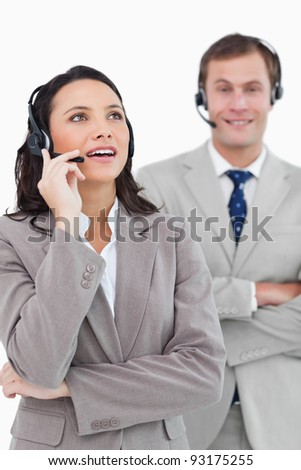 Call center agents standing together against a white background