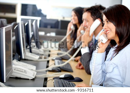 call center business team in an office full of computers