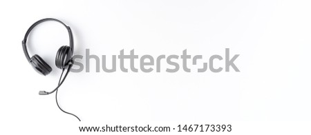Call center concept with helpdesk headphones on white background with copyspace. Banner