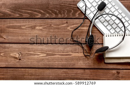 call center manager desktop top view wooden background