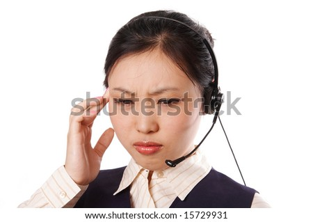 Call center operator wearing business suit standing on white with an annoyed expression.