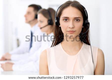 Confident Business Team Talking On Headset In A Call Center