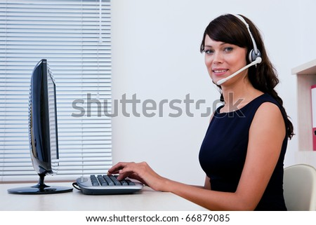 Call centre executive working on computer and interacting