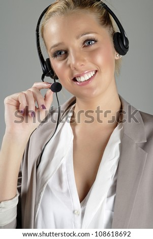 Call centre operator using a telephone headset.