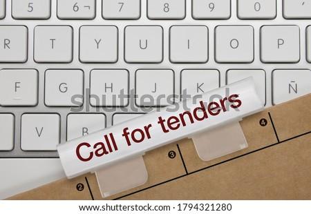 Call for Tenders Written on White Key of Metallic Keyboard. Finger pressing key. Stock photo ©