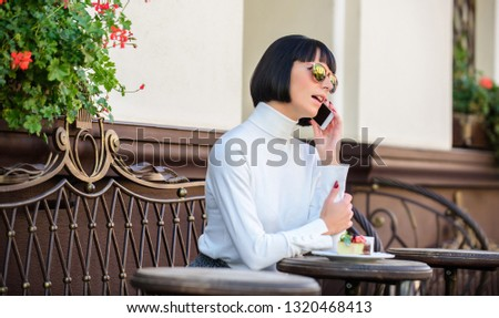Call friend. Relax and coffee break. Girl fashionable lady with smartphone. Leisure concept. Woman attractive elegant brunette spend leisure cafe terrace background. Pleasant time and leisure.