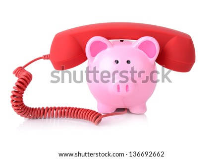 call the bank for support or telephone banking concept piggy bank with red phone receiver isolated on white