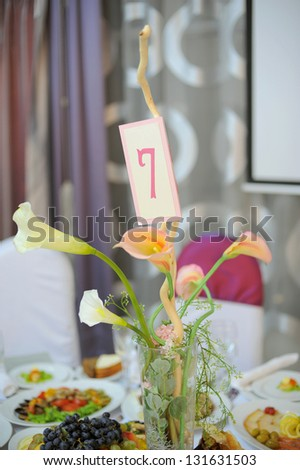 calla bouquet with number on decorated table