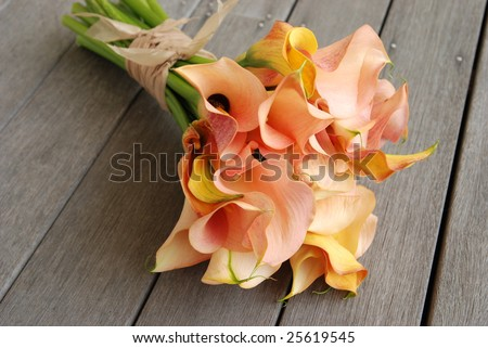 stock photo Calla Lilly Wedding Bouquet on deck