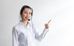 callcenter woman isolated on white background. Portrait Happy Asian woman operator and team working with headsets and desktop computer at telemarketing customer service.