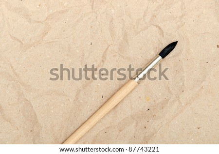 calligraphy brush on the blank sheet of paper