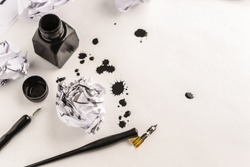 Calligraphy concept, pen for handwriting,spilled ink stains, brush,writing training,blank sheets of white paper ,Top view, place for text