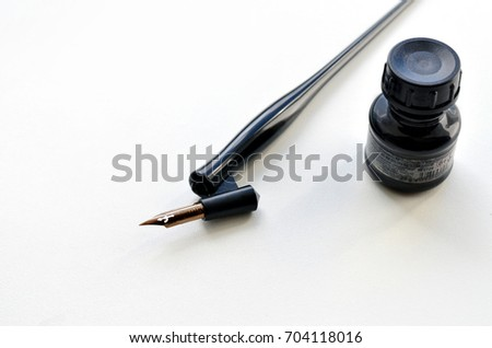 calligraphy pen and ink isolated on white background #704118016