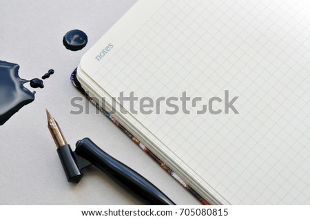 Calligraphy pen and notebook with ink blot. Workshop details #705080815