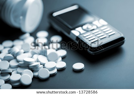calling for medical help: white pills and mobile phone