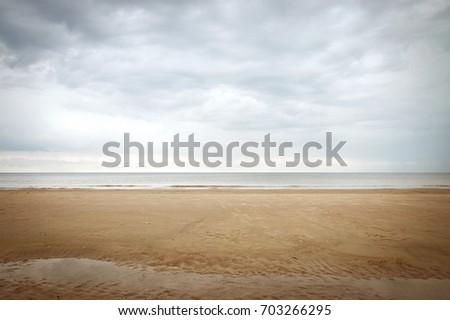 calm beach landscape in fall in ...