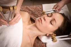 calm beautiful woman relax in spa. tuning forks sound healing therapy