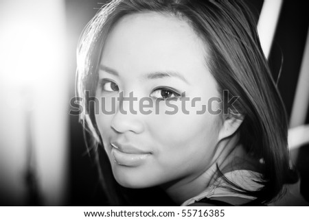 Calm black and white portrait of a young beautiful woman