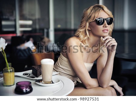 Calm blond beauty in a coffee shop - stock photo