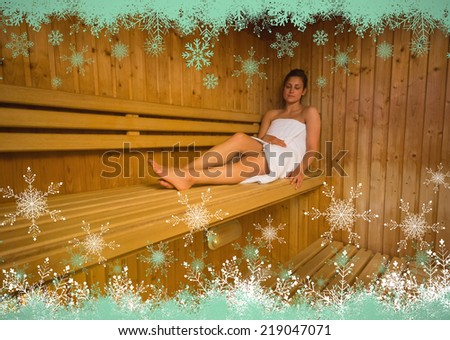 Calm brunette relaxing in a sauna against snow flake frame in green