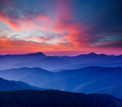 Calm evening landscape in the mountains at sunset. Colorful cloudy sky. Location place of Carpathian national park, Ukraine, Europe. Incredible natural wallpaper. Discover the beauty of earth.