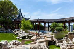 Calm Garden, traditional Chinese architecture with stone sculpture garden and lake in Malta, Santa Lucija.