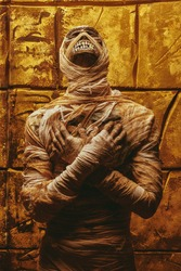 Calm Halloween mummy looks up against the background of a wall with ancient Egyptian hieroglyphs. Halloween. Ancient Egyptian mythology.