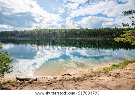 calm lake with reflections of...