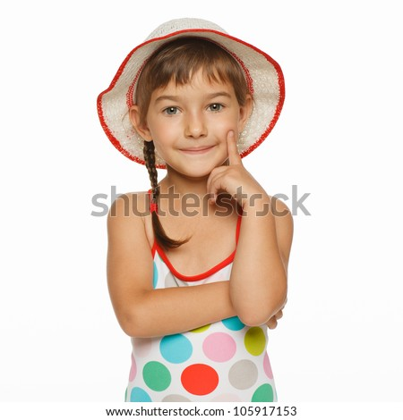 Calm little girl standing in swimming wear and panama hat, isolated over white background
