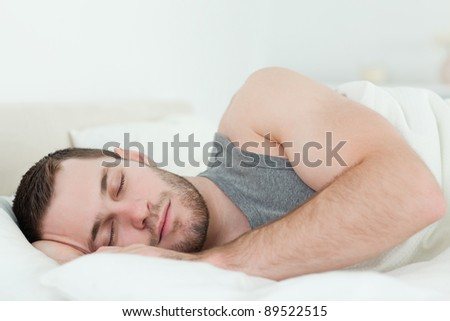 Calm man sleeping in his bedroom