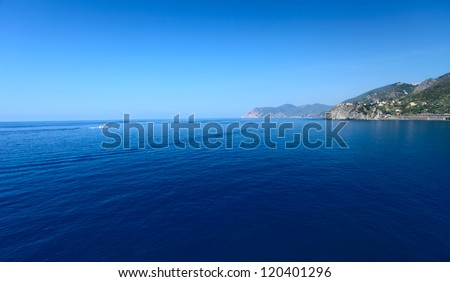 Calm Mediterranean sea and coast of Italian's Cinque Terre National Park