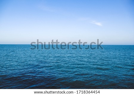 Calm mediterranean sea Ocean And Blue Sky Background waves soft surface, abstract background pattern