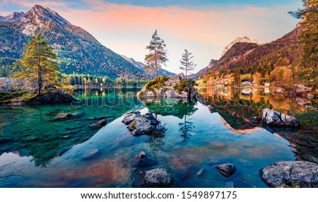 Calm morning scene of Hintersee lake with Hochkalter peak on background, Germany. Magnificent autumn view of Bavarian Alps. Beauty of nature concept background.
