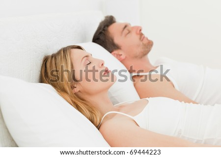 Calm pairs sleeping together at home