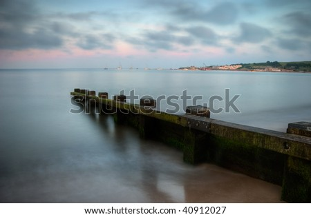 Calm sea at sunset in Swanage, Dorset (England)