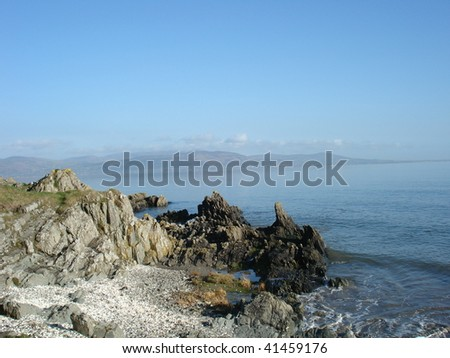 Calm Sea Lapping Against Rocks in Ireland