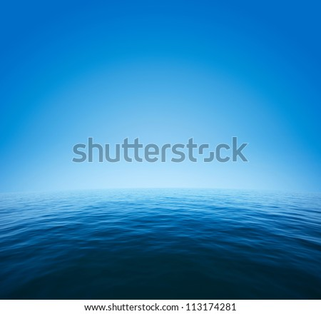 Calm sea with distorted surface and blue clear sky