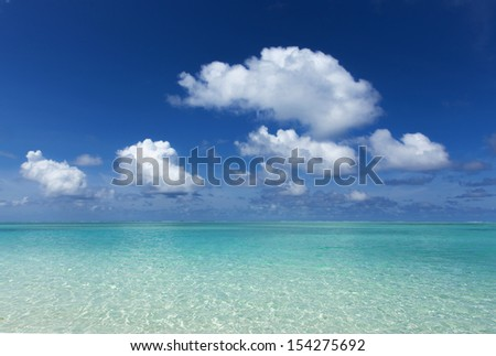 calm, turquoise sea, blue sky with white clouds